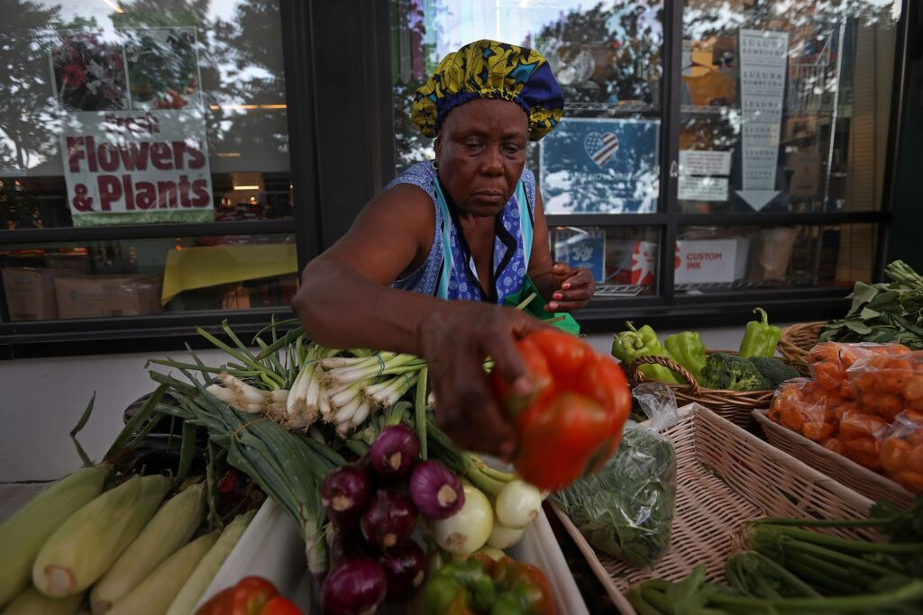 Garmi Mawolo at her fresh vegetable stand outside Urban Greens in Providence.BARRY CHIN/GLOBE STAFF